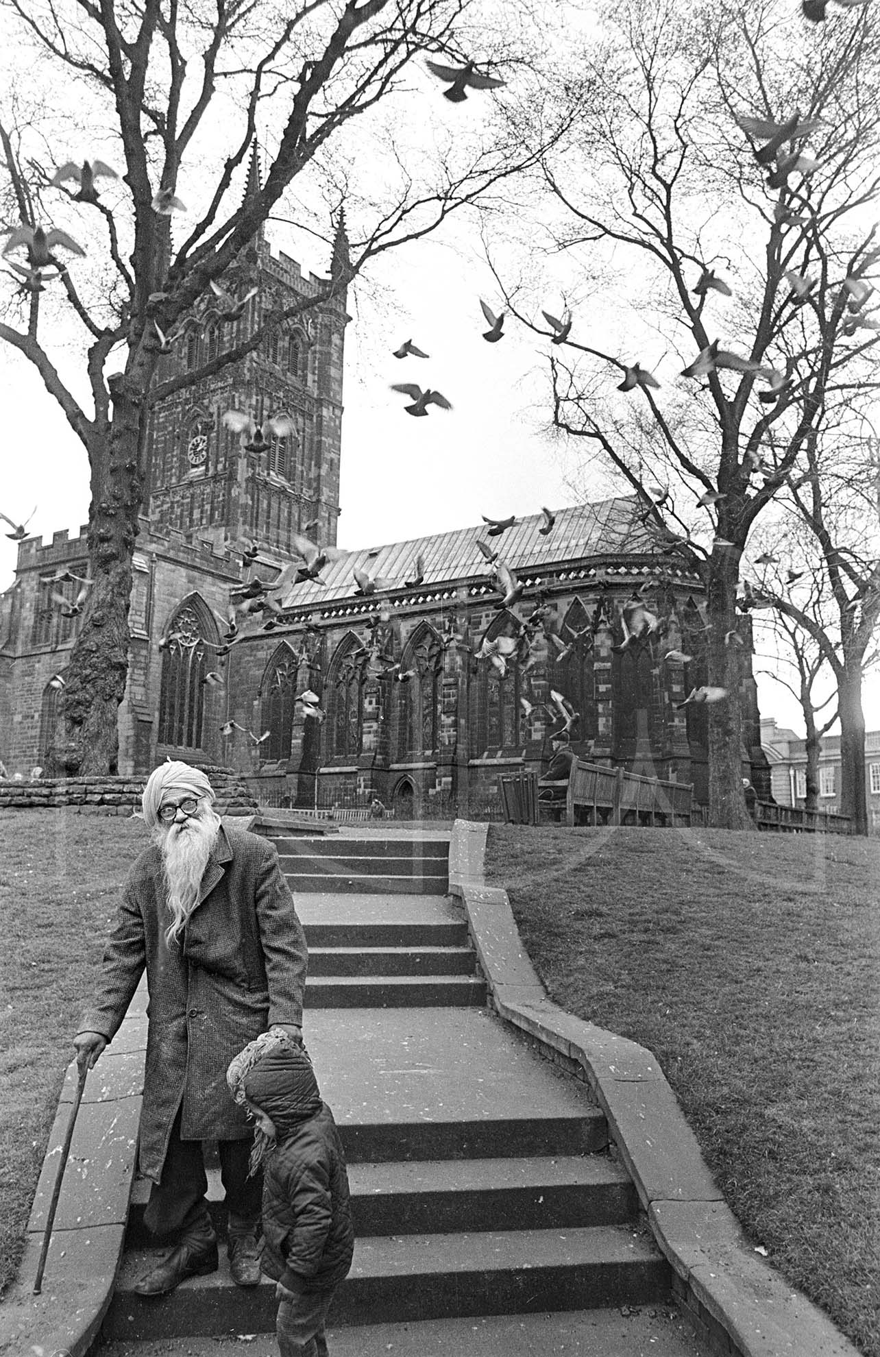 Sikh grandfather and grandson by St Peter's church Wolverhampton  (1976)