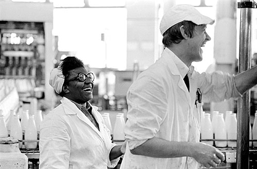 Colleagues at the dairy share a joke, Wolverhampton  (1977)