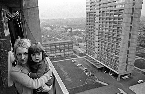 Mother and daughter on the balcony of their 13th floor tower block flat Leytonstone  (1974)