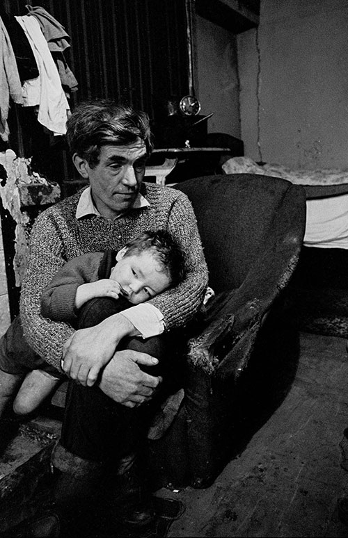 Father and child living in a condemned Gorbals tenement, Glasgow  (1970)