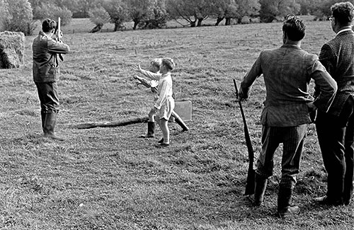 Boys ask for cartridge cases, clay pigeon shoot Worcs,  (1967)