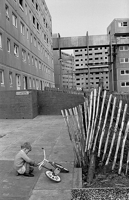Child playing amongst the new construction in Killingworth New Town, Northumberland  (1975)