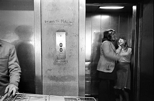 Girls in a lift in a shopping complex Birmingham  (1975)