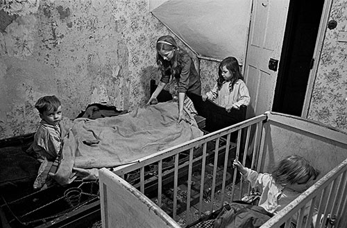 Mrs M puts her children to bed in their Balsall Heath slum 2, Birmingham  (1969)