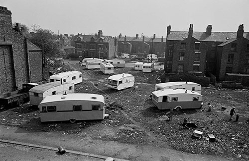 Travellers' vans occupy a slum cleared site, Manchester  (1969)