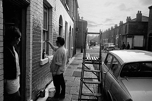 Repainting their house Salford  (1969)