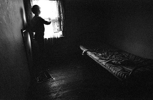 Mrs P's son in his bedroom, All Saints, Birmingham  (1968)