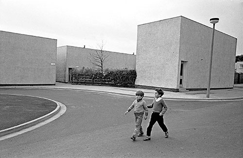Childen walking past award winning houses Killingworth New Town Northumberland  (1975)