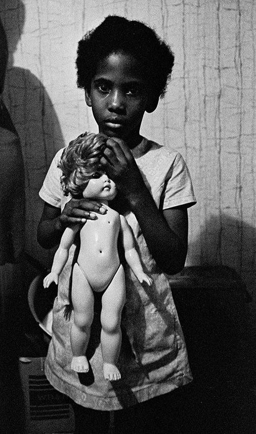 child with her doll, London  (1970)