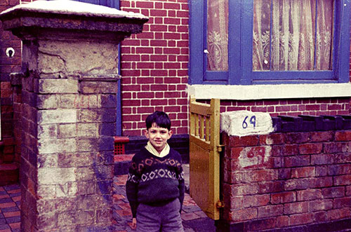 Boy and house exterior Handsworth  (1966)
