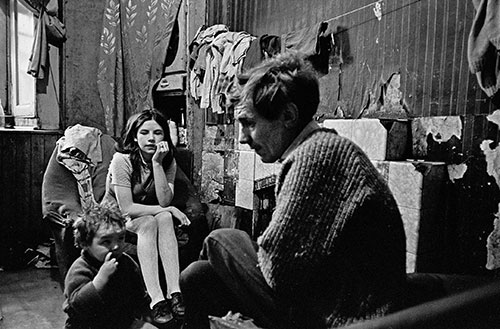Father and his family living in a Gorbals tenement, Glasgow  (1970)