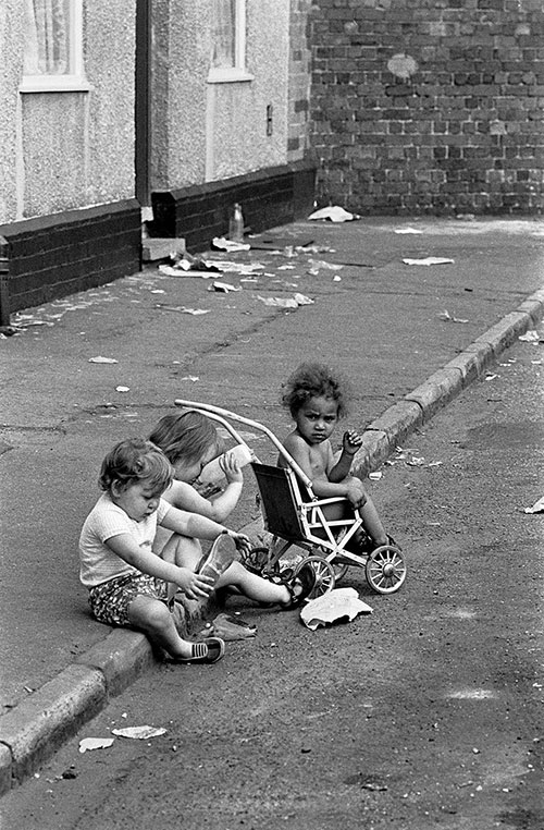 Children playing in the gutter of a street in Winson Green, Birmingham  (1971)