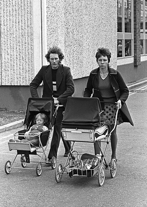 Family leaving a shopping precinct Bromsgrove  (1975)