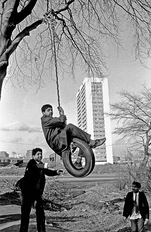 Boys playing by a new tower block Birmingham  (1975)