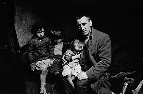 Mr O and his children living in a condemned Liverpool house,  (1969)