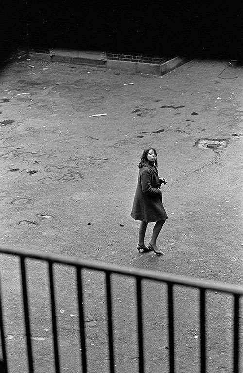 Crossing the courtyard of a homeless hostel, Southwark London  (1971)