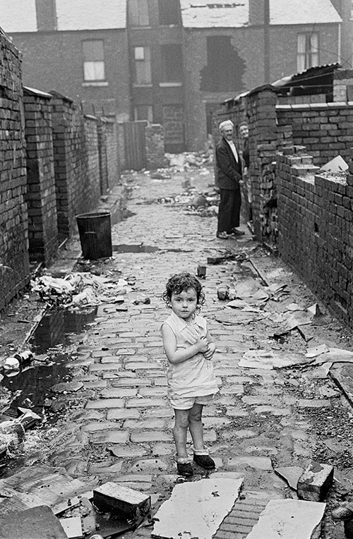 Little toddler wandering alone in Manchester alleyway,  (1972)