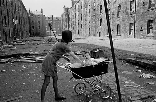 Mother and her baby boy in a Gorbals tenement yard  (1970)
