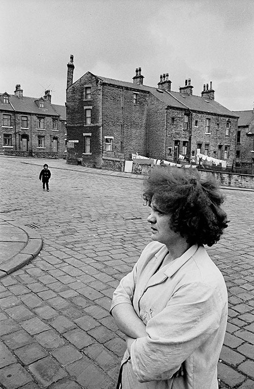 Mother waiting for her child to come home from school, Bradford  (1969)
