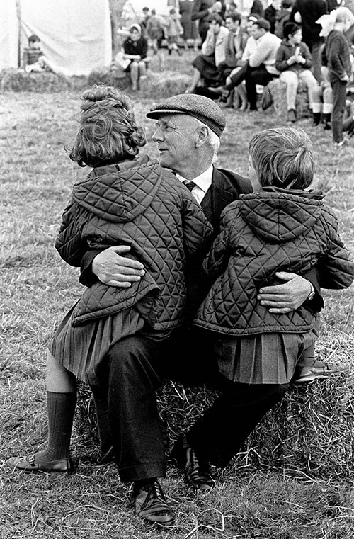 Grandfather and his grandchildren, agricultural show, Bromsgrove Worcs  (1967)
