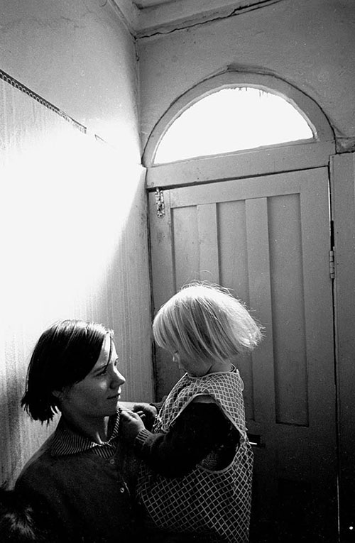 Mother and daughter living in slum housing, Birmingham  (1968)