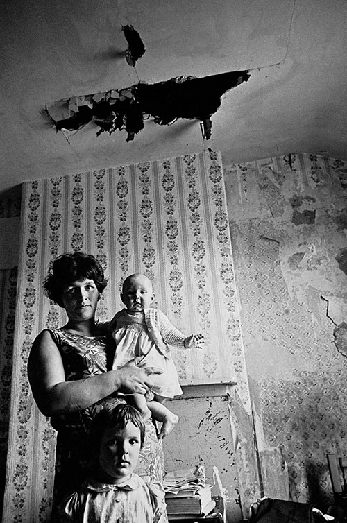 Mother and her children in their decaying Birmingham home  (1969)