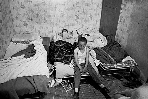 Child in his overcrowded bedroom  (1971)