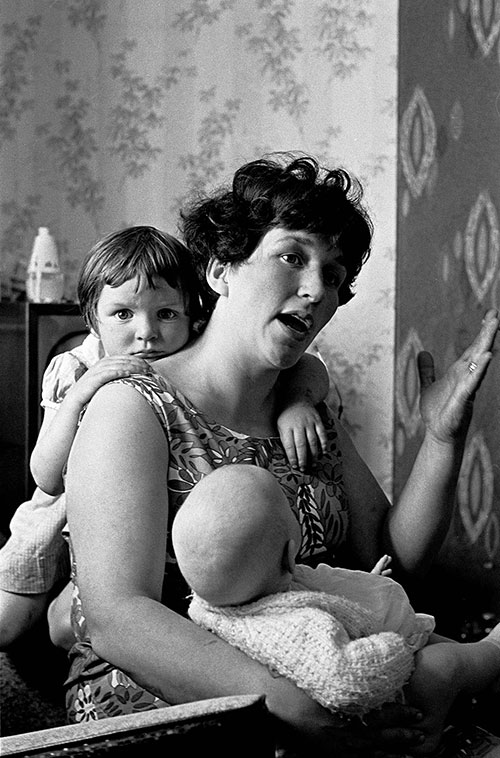 Mother and her family living in a Birmingham slum property,  (1969)
