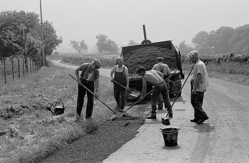 ex farm workers repair the road, Wichenford Worcs  (1969)