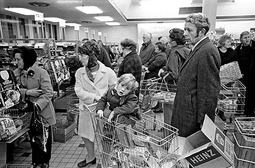 Family in a queue, supermarket Northfiel Birmingham  (1975)