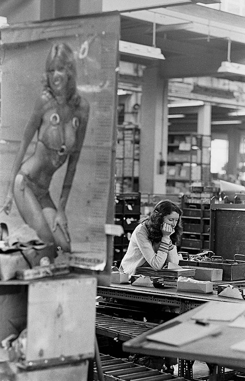 Travel poster and girl in packing department, Josiah Parkes lock factory Willenhall  (1976)