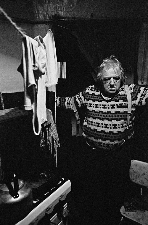 Senior citizen living in a damp basement tenement flat South London  (1971)