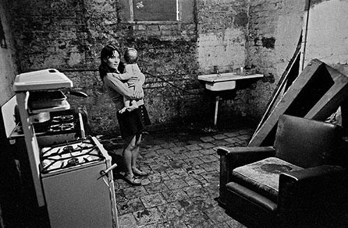 Mother and baby in the cellar kitchen of their Liverpool home,  (1971)