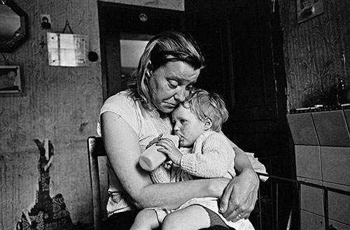 Mrs T and her youngest child, living without electricity or gas, Sheffield  (1969)