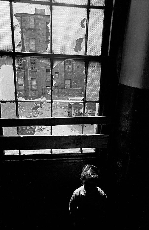 Child on the staircase of his tenement home, Glasgow  (1971)