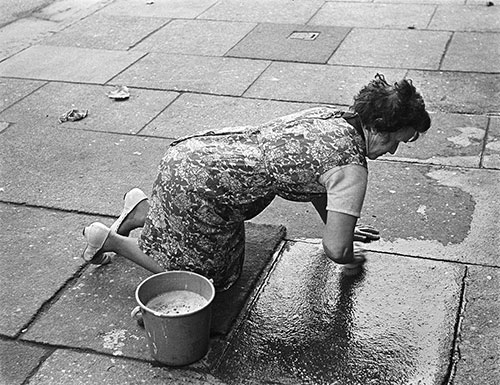 Scrubbing the pavement outside her Liverpool house,  (1969)
