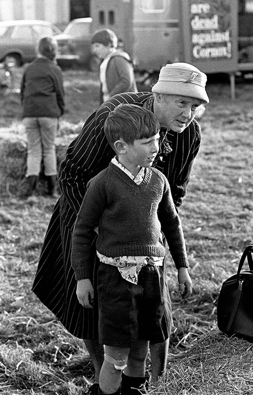 Granny tucks a boy's shirt in, agricultural show, Bromsgrove  (1967)