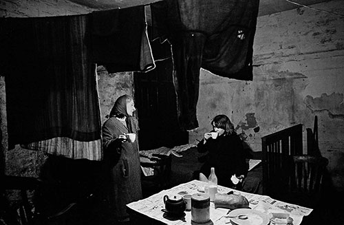 Mrs D and her daughter 2 in their Liverpool cellar flat  (1969)