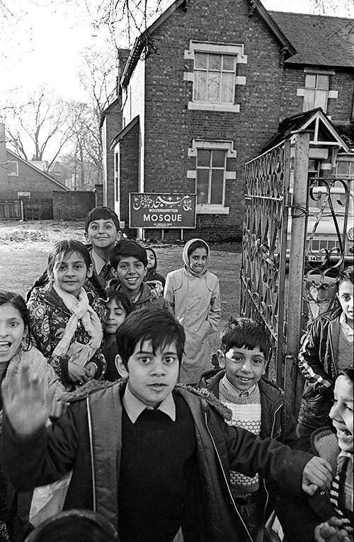 Children outside the temporary home of the Mosque Wolverhampton  (1976)