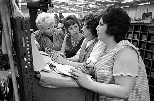 Line managers discuss output figures, Josiah Parkes, Willenhall  (1976)