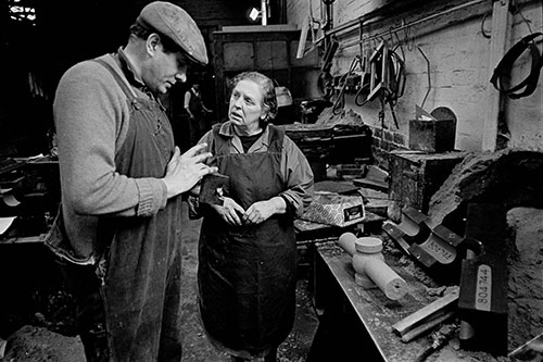 Colleagues discussing moulds, Lee Howl pump factory  (1978)