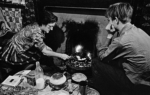 Cooking on an open fire, gas and electrics cut off , Liverpool  (1971)