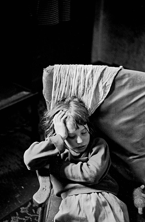 Mrs T daughter asleep in an armchair Sheffield  (1969)
