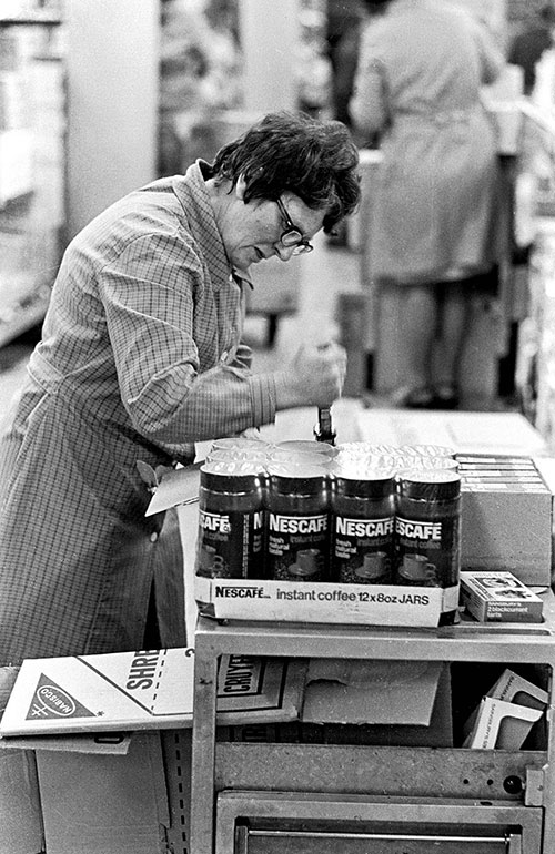 Worker pricing products, supermarket Birmingham  (1975)