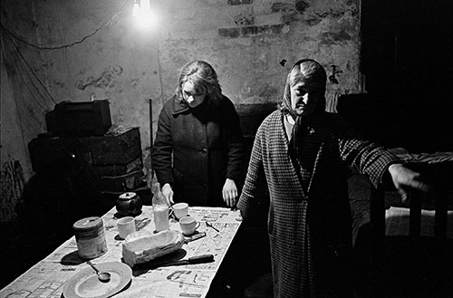 Mrs D and her daughter in their cellar flat Liverpool  (1969)