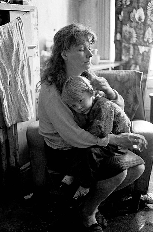 Mother and son living in a slum property in Newcastle's West End  (1971)