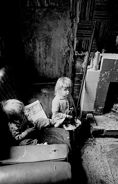 Two children with their comic 'The Rocky Road to Nowhere', Salford (1971)