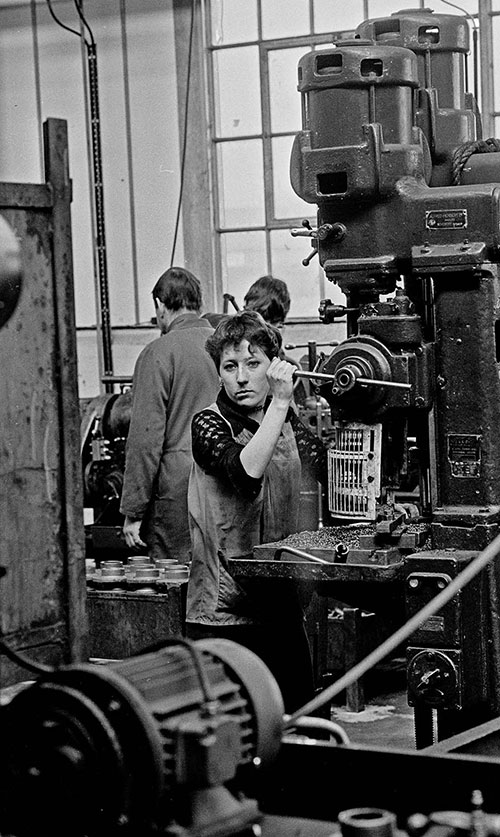 Girl pulling lever on a drilling machine, Lee Howl pump factory Tipton  (1978)
