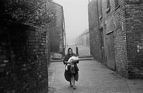 Mother and baby walking through a Liverpool alleyway,  (1969)