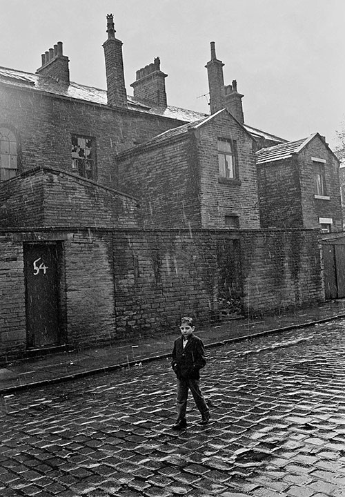 Child walking home through the rain, Bradford  (1969)